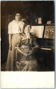 Vintage RPPC Real Photo Postcard Two Young Ladies Sisters at Piano Parlor c1910s