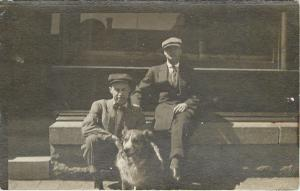 Two Men And Their Small Dog w/Furry Chest~Real Photo Postcard