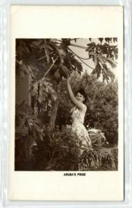 aruba, N.W.I., Girl picking Papaya Fruit Tree (1940s) RPPC