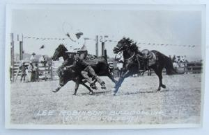 RPPC VINTAGE PHOTO POSTCARD RODEO LEE ROBINSON BULLDOGGING horses