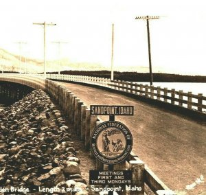 RPPC Sandpoint Idaho ID World's Longest All-Wooden Bridge NFBP Sign Postcard