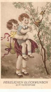 Little girls looking at birds in nestLovely vintage postcard