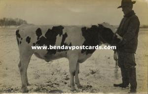 Canada or US (?), Proud Farmer with Bull Cow in the Snow (1910s) RPPC
