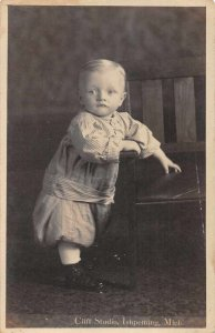 Ishpeming Michigan Baby by Chair Real Photo Vintage Postcard JF686378