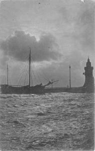 Small Sailing Ship Docked by Shore by Lighthouse?~Postcard pm 1910 @ Sawyer WI