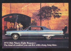 1974 OLDSMOVILE 98 REGENCY CAR DEALER ADVERTISING POSTCARD STOUGHTON WISCONSIN