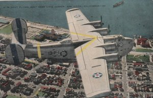 SAN DIEGO, California, 1940s; U. S. Navy Flying Boat flying over Civic Center