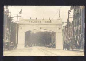 RPPC WELCOME ARCH WWI ERA DOWNTOWN STREET SCENE REAL PHOTO POSTCARD