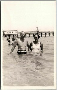 1940s Bathing / Swimming RPPC Real Photo Postcard Couple in Ocean / Pier View