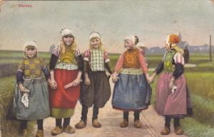 5 Blond Girls in Traditional Dutch Dress & Clogs Holding Hands, Marken, North...