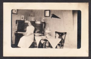 Mabel at the Piano in the Parlor - 1913 - real photo – RPPC