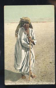 NEEDLES CALIFORNIA OLD MOJAVE INDIAN WOMAN ON THE DESERT VINTAGE POSTCARD