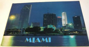 United States Miami Skyline at night with centrust Tower - posted 1991