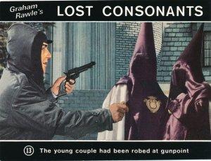 Graham Rawle's Lost Consonants - Humor - Pun - Couple Robed at Gunpoint