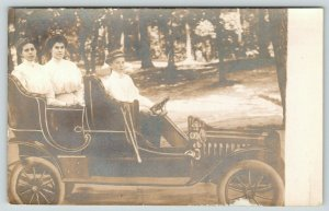 RPPC Mom & Sister Let Pre-Teen Boy Drive Car in Studio Prop Shot~Side View~c1910