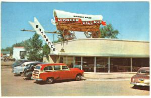 Minden NE Pioneer Village Entrance Covered Wagon Woodie Old Cars Postcard