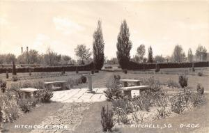 Mitchell South Dakota~Hitchcock Park Scene~Flower Gardens~Stone Benches~40s RPPC