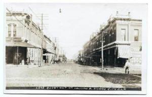 Dodge City KS Dirt Street View Vintage Store Fronts Bowers RPPC Postcard