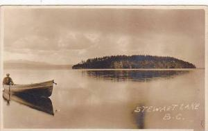 RP: Man in Row Boat in the middle of Stuart Lake, British Columbia, Canada, 1...
