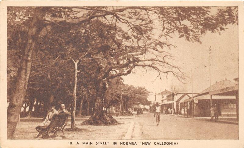 Noumea New Caledonia~A Main Street~Couple on Bench~Storefronts~Trees~c1920s Pc