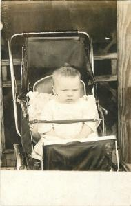 Real Photo Postcard~Frowning Baby Charles Ellwood~Strapped in Stroller~1910 RPPC