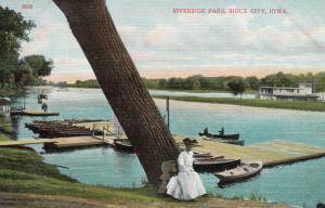 SIOUX CITY , Iowa, 1900-1910s; Riverside Park, Woman sitting beside tree