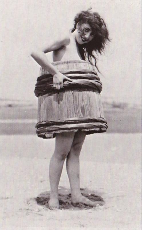 Humour Woman On Beach Wearing Barrel