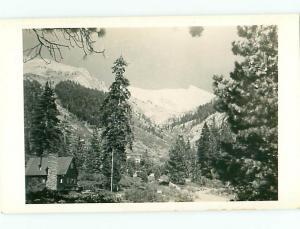 RPPC Mountains Cabin Snow Peaks Chomney Fireplace  Postcard # 5491