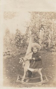 RP: Child Cowgirl on a rocking Horse , 1901-07