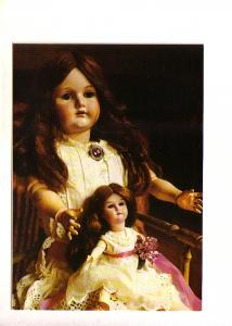 Doll with Doll on Her Lap Both Wearing White Dresses
