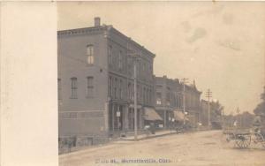 E71/ Garrettsville Ohio RPPC Postcard c1910 Main Street Stores I.O.O.F.
