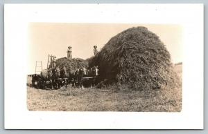 Real Photo Postcard~Farmers on Hay Mound Pitch Fork to 4 Horse Team Wagon~c1910