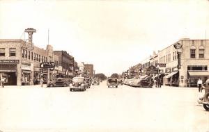 Spencer Iowa~Main Street~Theatre~Jewelry~Jones~Bjornstad Drug~Cars~1936 RPPC