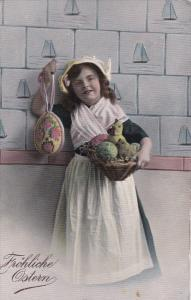 EASTER; Frohliche Ostern, Girl solding decoration eggs, hen and chicks in bas...