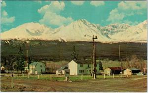 HAINES JUNCTION, Yukon Canada  View of TOWN, ST ELIAS MTNS   c1950s  Postcard