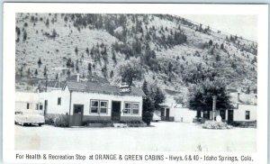 IDAHO SPRINGS, Colorado CO  Roadside ORANGE & GREEN CABINS Highway 40  Postcard