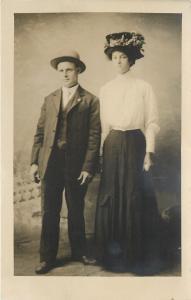 White Cloud Michigan~E G Branch Studio~Stiff Man & Fancy Hat Woman~RPPC c1920