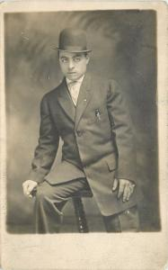 Sully Sitting At 21 On A Chair~Lapel Pin~Pocket Pen~Bowler Hat RPPC c1913