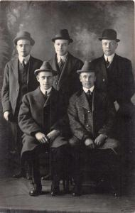GROUP OF 5 MEN~ALL WEARING HATS~BROTHERS?~REAL PHOTO POSTCARD 1910s