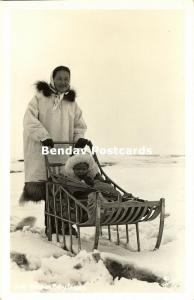 Alaska, Native Eskimo Woman with Baby Buggy, Sledge (1950s) RPPC