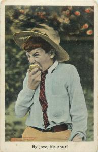 Bamforth humour postcard boy earing fruit comic face grimace By jove, it`s sour!