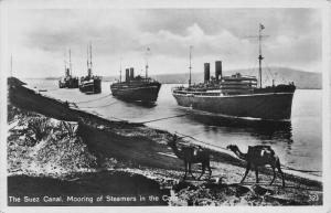 Egypt The Suez Canal Mooring of Steamers in the Canal Boats Postcard