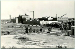 1940s INTERNATIONAL FALLS, MN RPPC Photo Postcard Birdseye View of Paper Mill