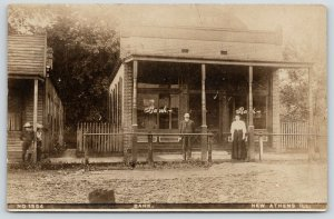 New Athens Illinois~Bank Close Up~Cashier & Lady Clerk Out Front~1908 RPPC