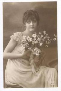 RP  Woman holds bouquet of flowers, 00-10s