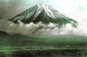 Postcard, Snow Covered Mount Fuji wreathed in Low Cloud, Japan c1910 J10