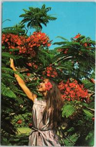 Beautiful woman reaching for flowers in St. Thomas, Virgin Islands