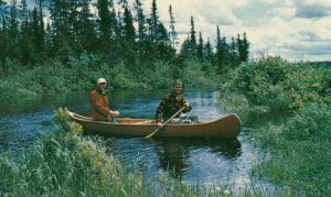 UPSALA , Ontario , Canada , 50-60s ; Men in canoe looking for fishing spot