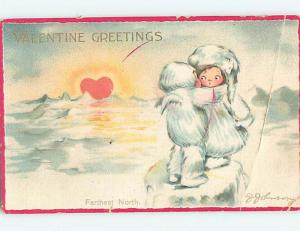 Bent Pre-Linen valentine signed BOY HUGS CUTE GIRL AT THE NORTH POLE HJ2289