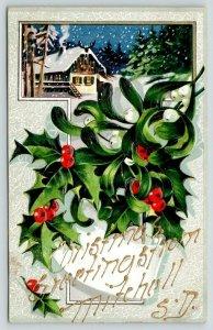 Mitchell South Dakota~Christmas Greetings~Embossed Holly~Snowy Winter Scene~1910